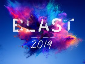 A cloud of colourful powder with the words Blast 2019 written infront of the colourful powder