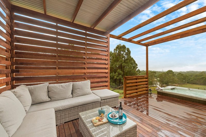 Relax at the outdoor lounge area near hot tub