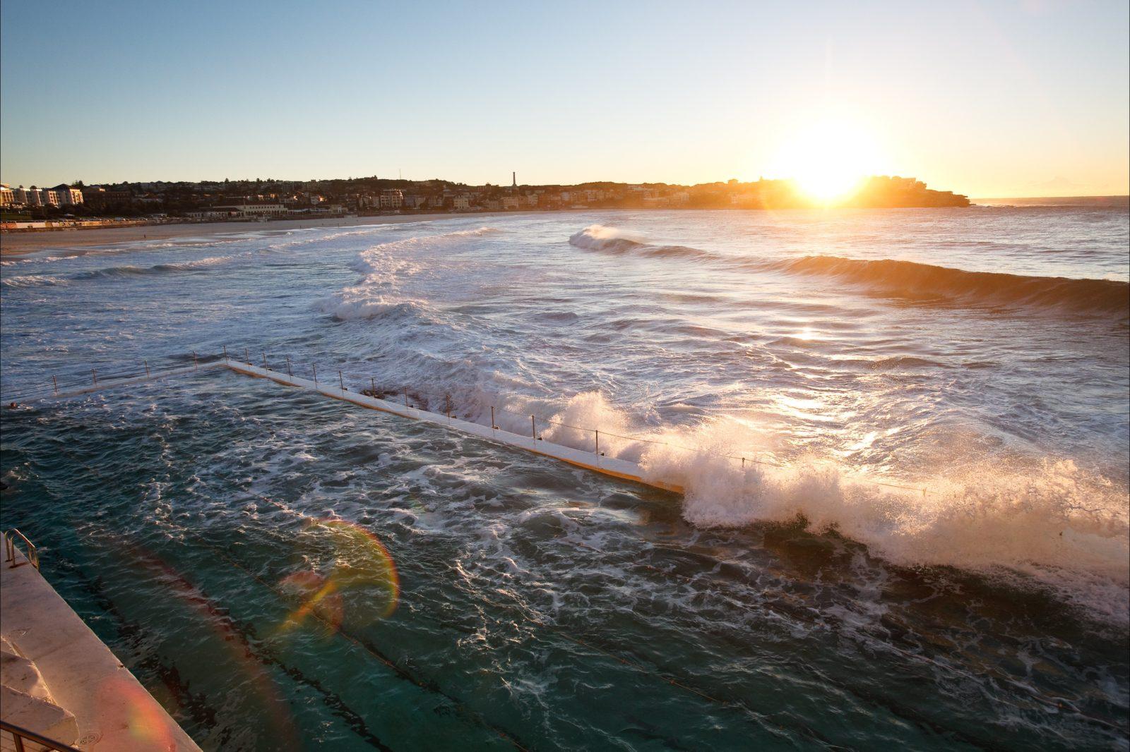 Sunrise at Bondi Beach with Bondi ocean pool in foreground. View from Bondi Icebergs Club
