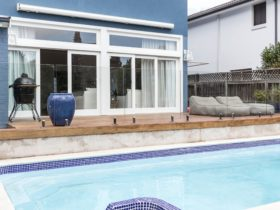 You'll love the private and shimmering swimming pool