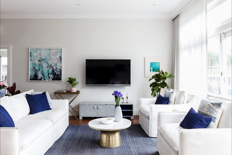 You'll love the white & blue color palette in the living area