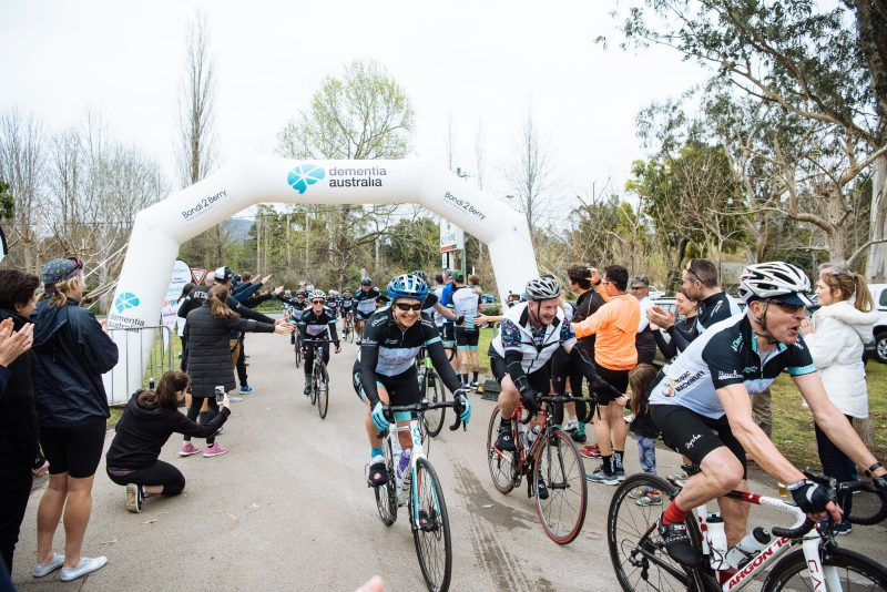 Riding through the blow up archway to the finish at Berry Bowling Club
