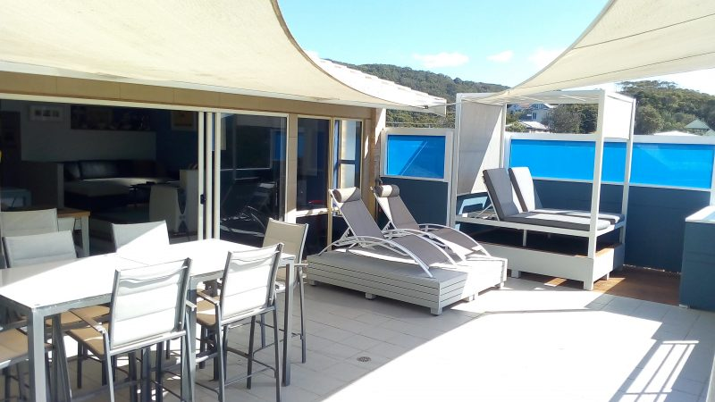 View deck with sunlounges, day bed and otdoor dining & BBQ