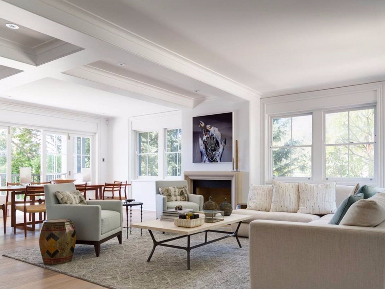 Bright living room surrounded by windows