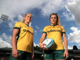 Grace Hamilton and Emily Chancellor pose during the Wallaroos media session at North Sydney Oval