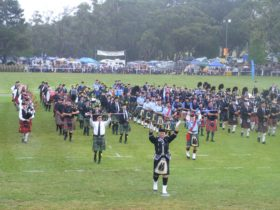 massed bands advancing Opening Ceremony