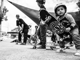 Kids learning to ride skateboards