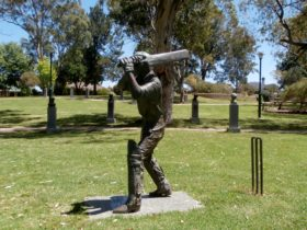 Sir Donald Bradmans life size scupture in the Captains Walk Jubilee Park