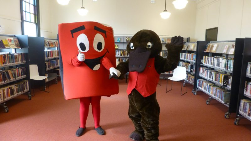 Reading mascots Book Bob, shpaed like a book and gint platypus Freed the Reader at Forbes Library