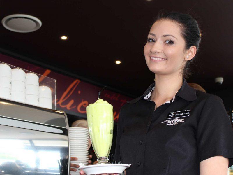 Waitress holding a milkshake