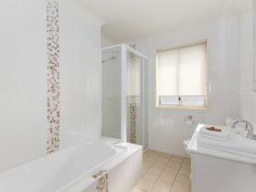 Bathroom with separate bath tub
