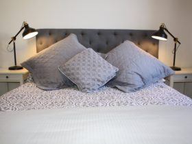 Bed with luxury cushions and linen