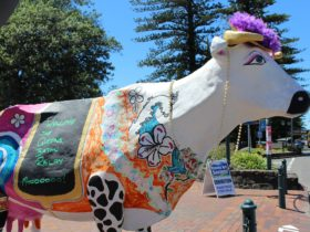 Daisy the Decorated Dairy Cow outside the Old Fire Station