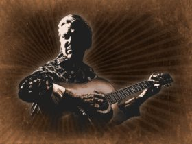 Painting of Glenn Campbell holding a guitar