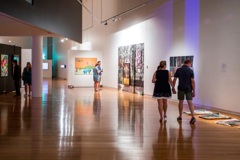 Couples enjoying an art exhibition during Date Night