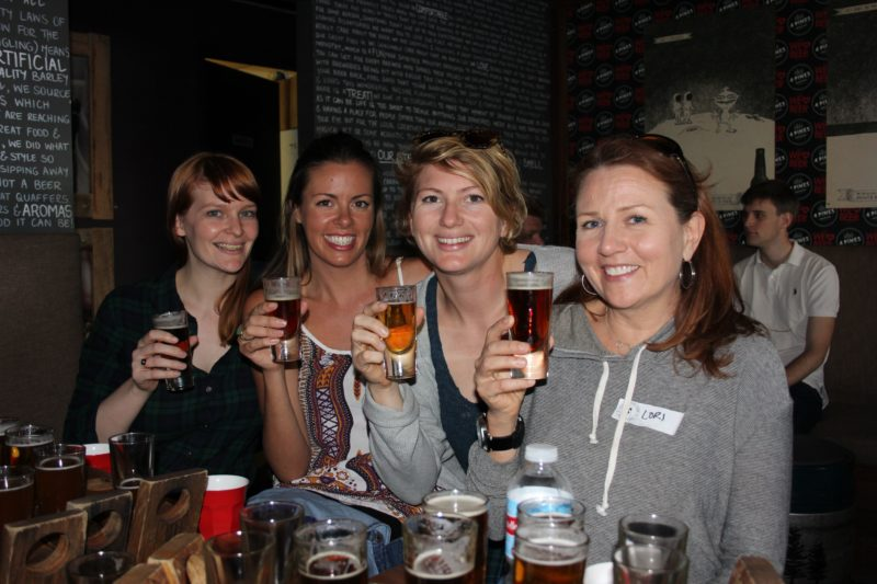 Tour guests enjoy a beer at a micro breweries