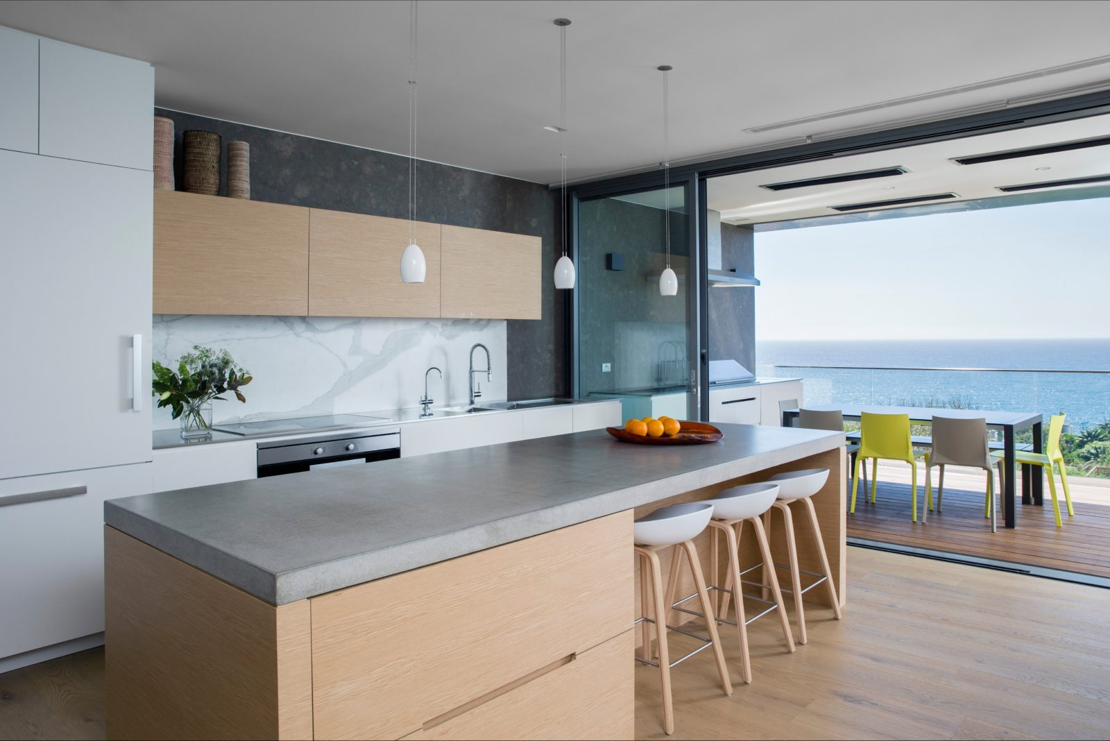 Open plan kitchen with access to large terrace with dining area and seaview