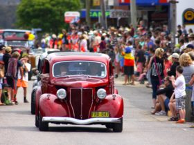 Old cars in a street parade