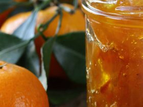 Image of a jar of marmalade and an orange
