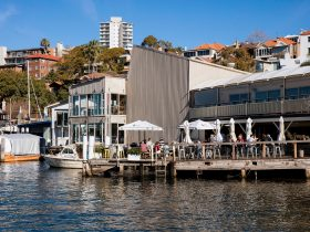 Patrons at Bayly's Restaurant enjoying waterside dining at the Ensemble Theatre, Kirribilli
