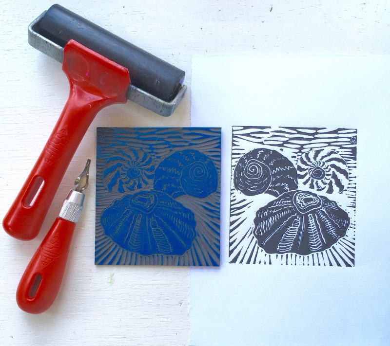 printing roller, cutting tool, carved lino tile and black & white print of shells