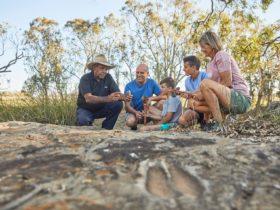 Aboriginal tour guide with family