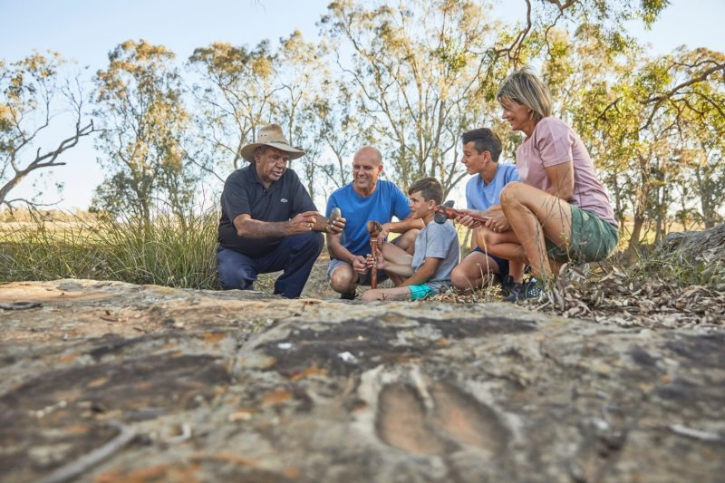 Aboriginal tour guide with family