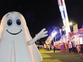 A man in ghost costume at the carnival
