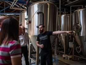 A member of the FogHorn Brewhouse staff conducts a tour in the middle of the brewery