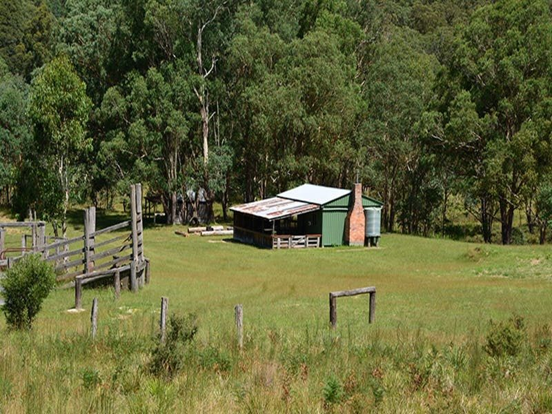 Exterior of Four Bull Hut and surrounding valley, Washpool National Park. Photo: Ann Richards/DPIE