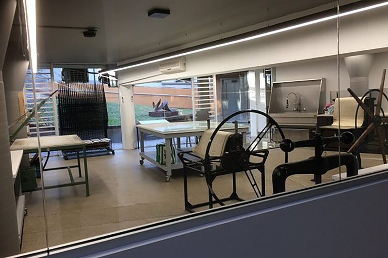 Photograph of printmaking studio, fit with a variety of relief and intaglio presses.