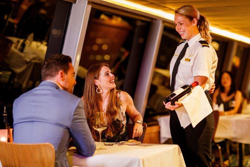 Waitress explaining wine