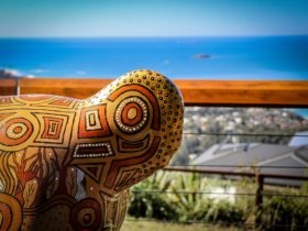 Guula the Koala sculpture takes in the view from Korora Lookout
