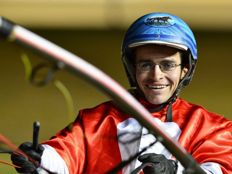 Harness race rider smiling