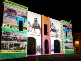 A series of archival images from 1888 to 1938 projected on the historic Town Hall Facade Broken Hill