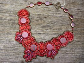 One of the stunning one of a kind beaded collars you will find at Holey Glass Beadery and Jewellery Gallery