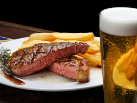Steak with fries and beer