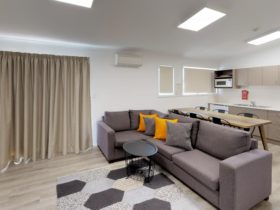 Jindabyne's living room in the two bedroom apartment