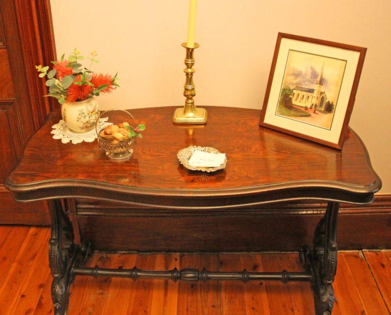 Rosewood veneer on Mahogany table