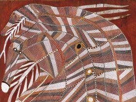 Detail of female rainbow serpent paintedon bark by Mawurndjul with fine cross hatching called rarrk