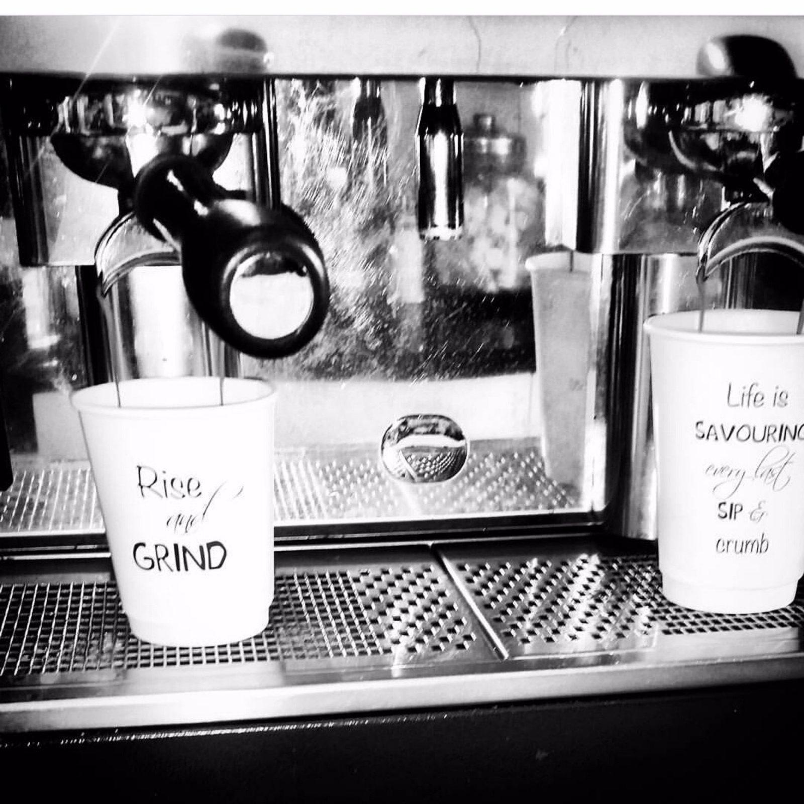 Coffee cups at Kaffeine coffee shop