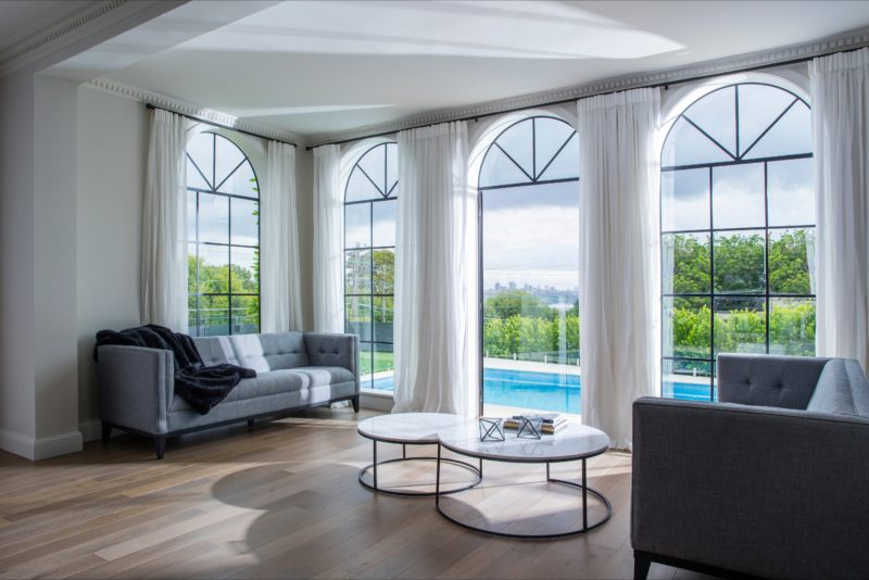 Living room giving views to the outdoor swimming pool