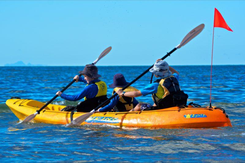 Three children in kayak