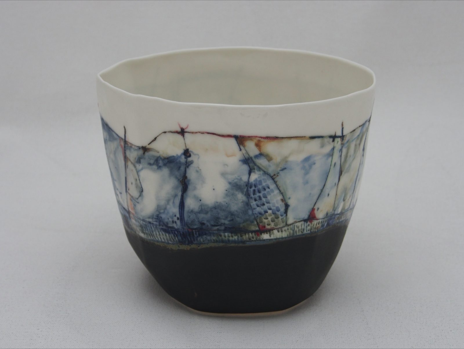 Medium size bowl made of porcelain clay with hand painted abstract landscape design and gold lustre.