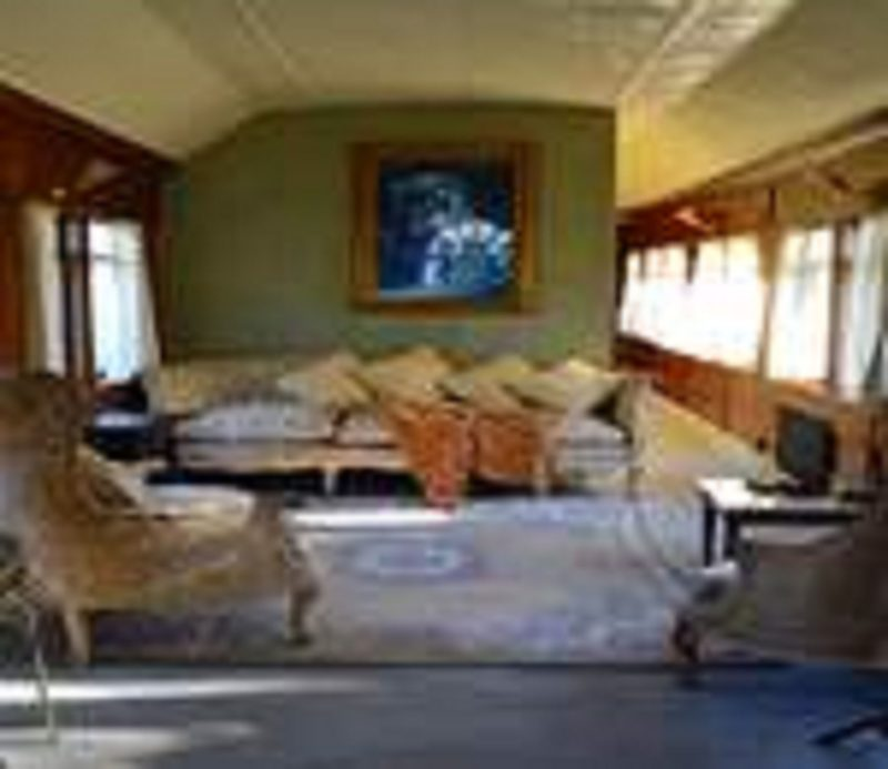 Krinklewood Cottage and Train Carriages