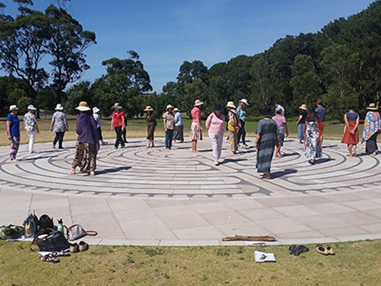 people walking on labyrinth