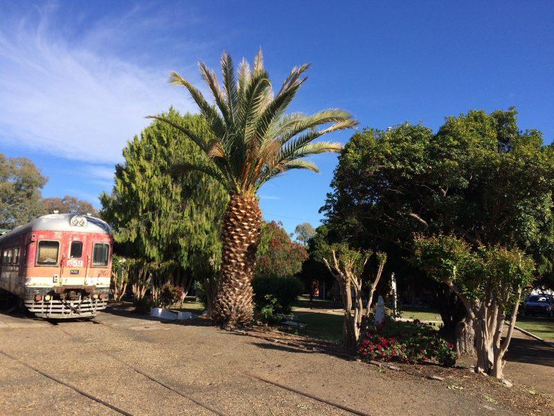 Diesel rail car next to the Depot Garden and War Memorial