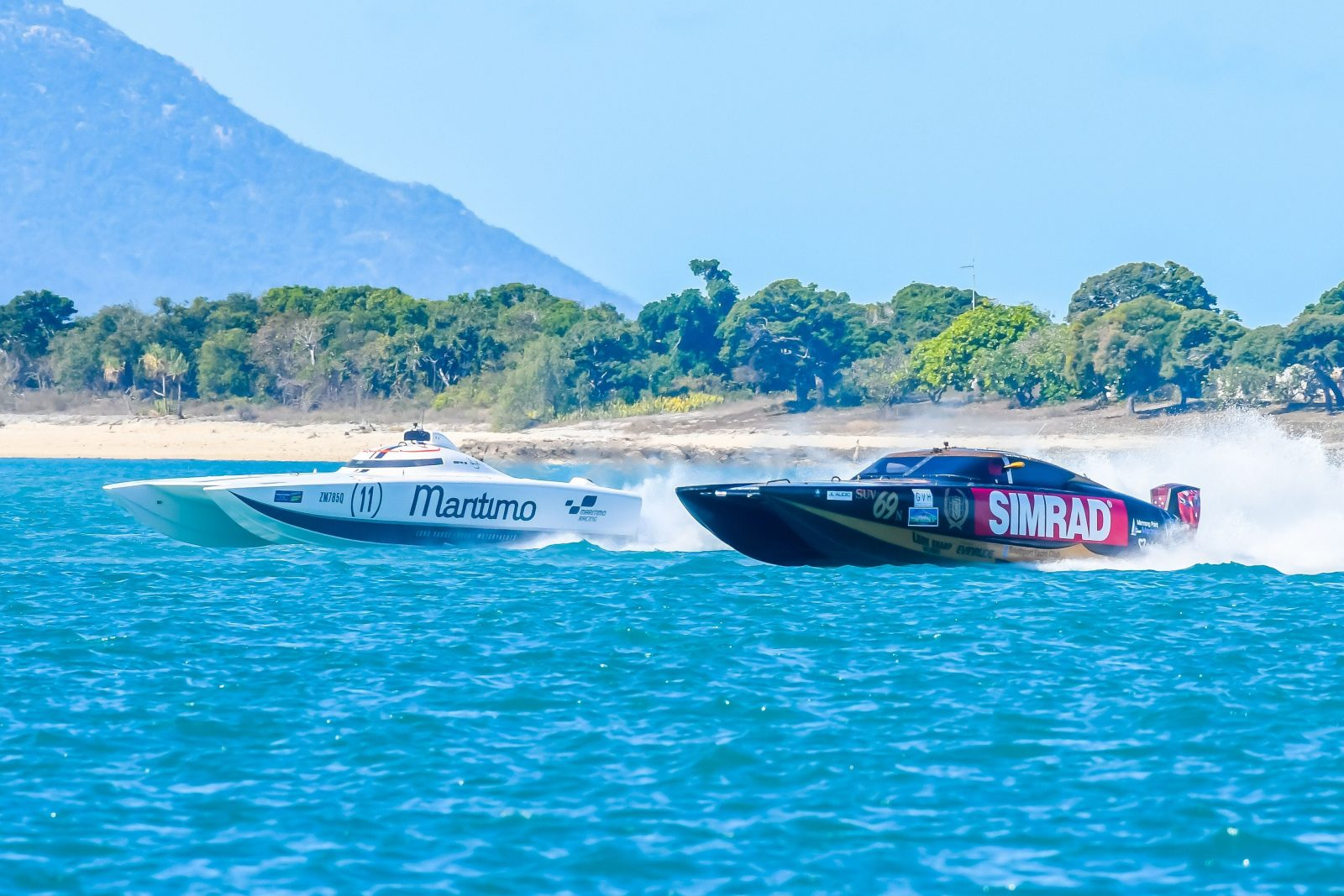 Two superboats racing on the ocean
