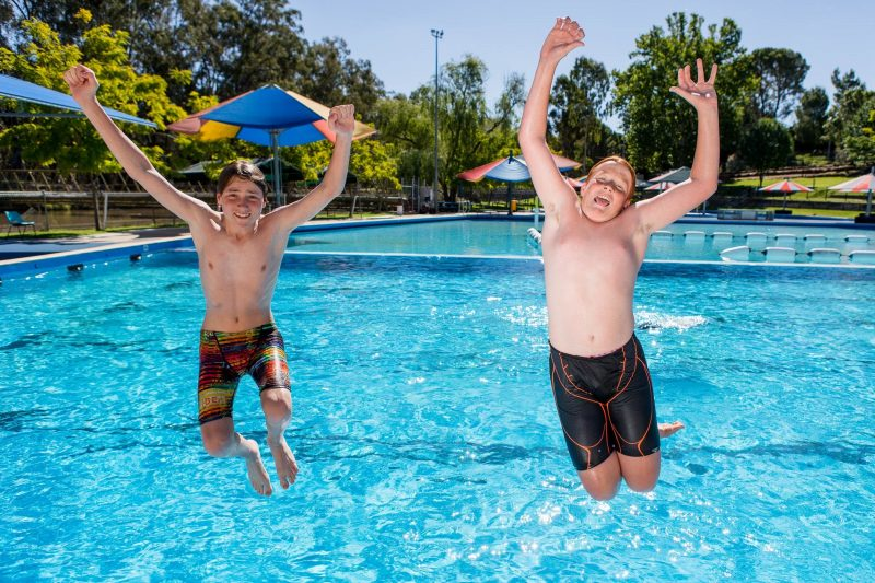 Boys jumping into Lake Talbot Swimming Complex