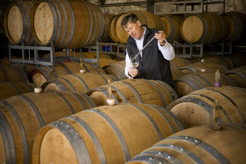 Winemaker Dave Carpenter testing the wine from the barrels